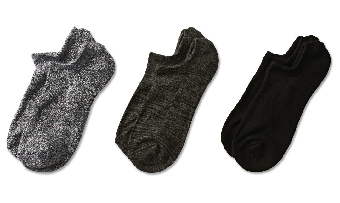 three pairs of bamboo bootie socks in gray, charcoal, and black
