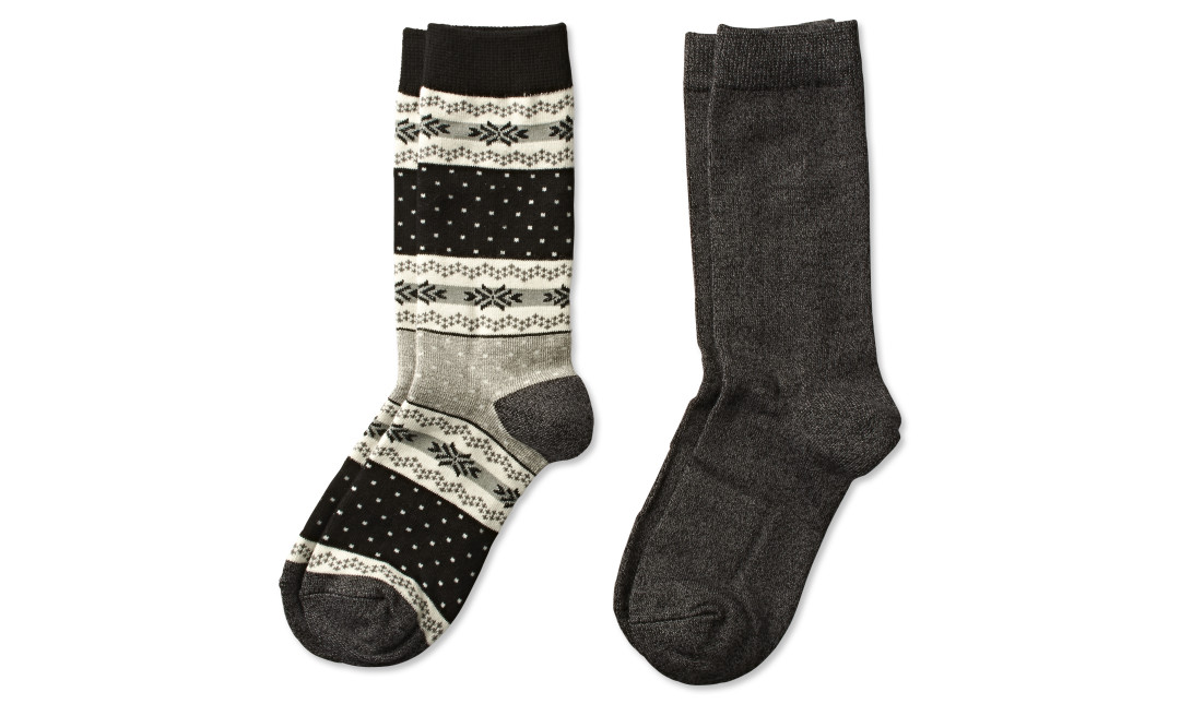 two pairs of crew socks in black fair isle print and solid black