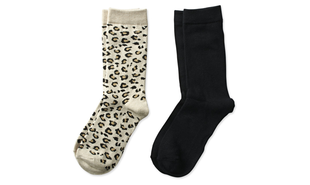 two pairs of crew socks in cheetah print and solid black