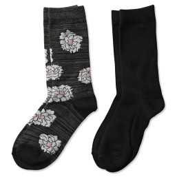 two pairs of crew socks in a floral pattern and solid black