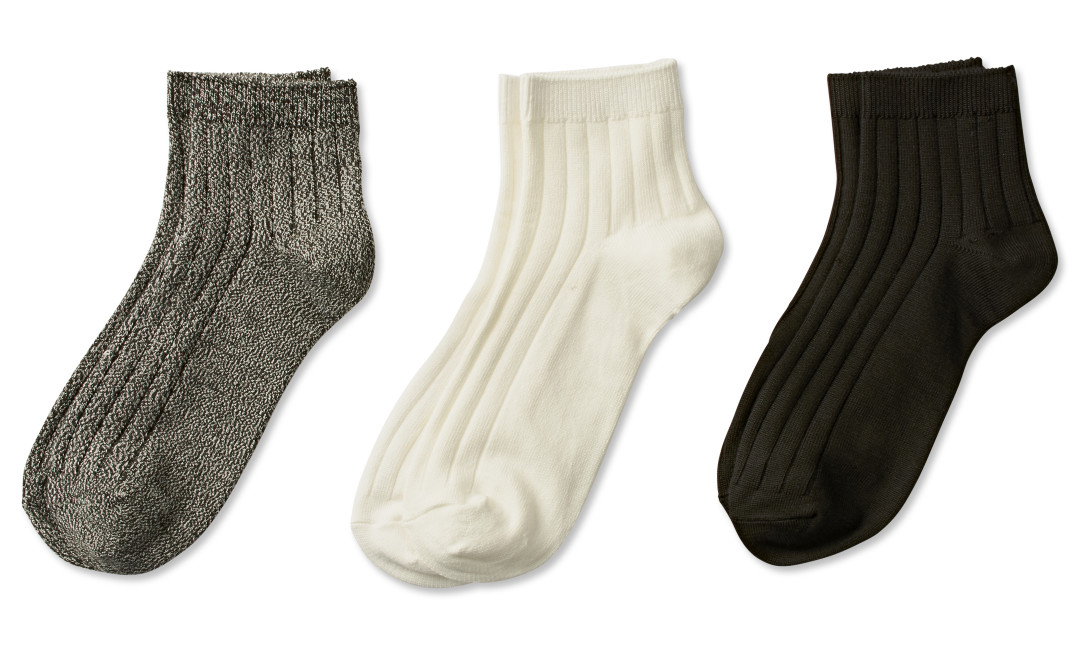 three pairs of quarter socks in gray, ivory, and black
