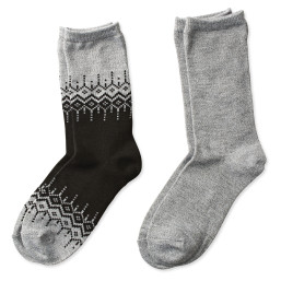 two pairs of crew socks in black and gray nordic print and solid gray
