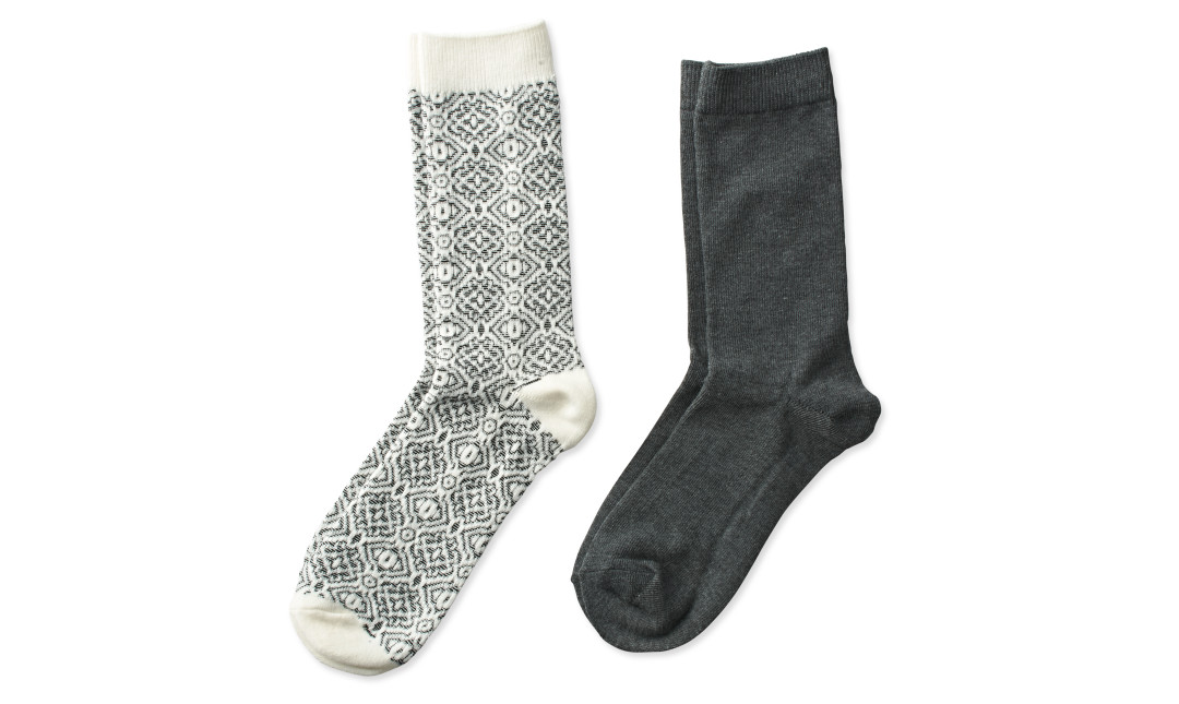 two pairs of crew socks in ivory with gray print and solid gray